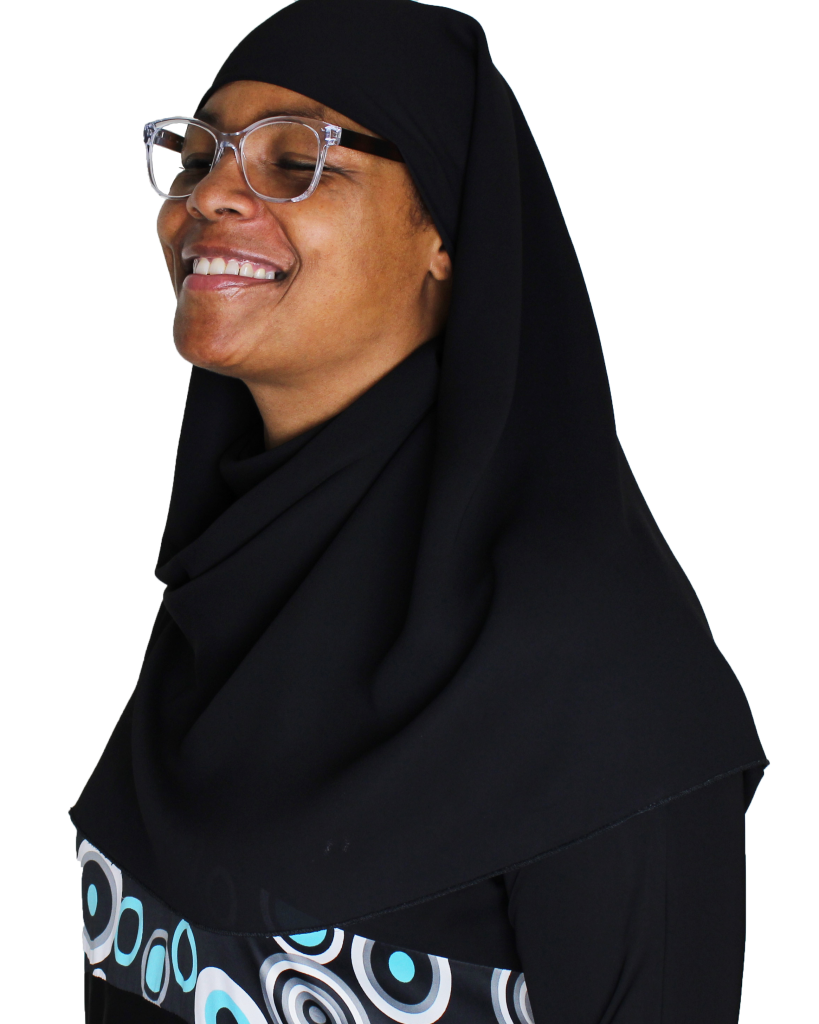 Portrait of female-presenting, brown-skinned person smiling wearing a khimar.
