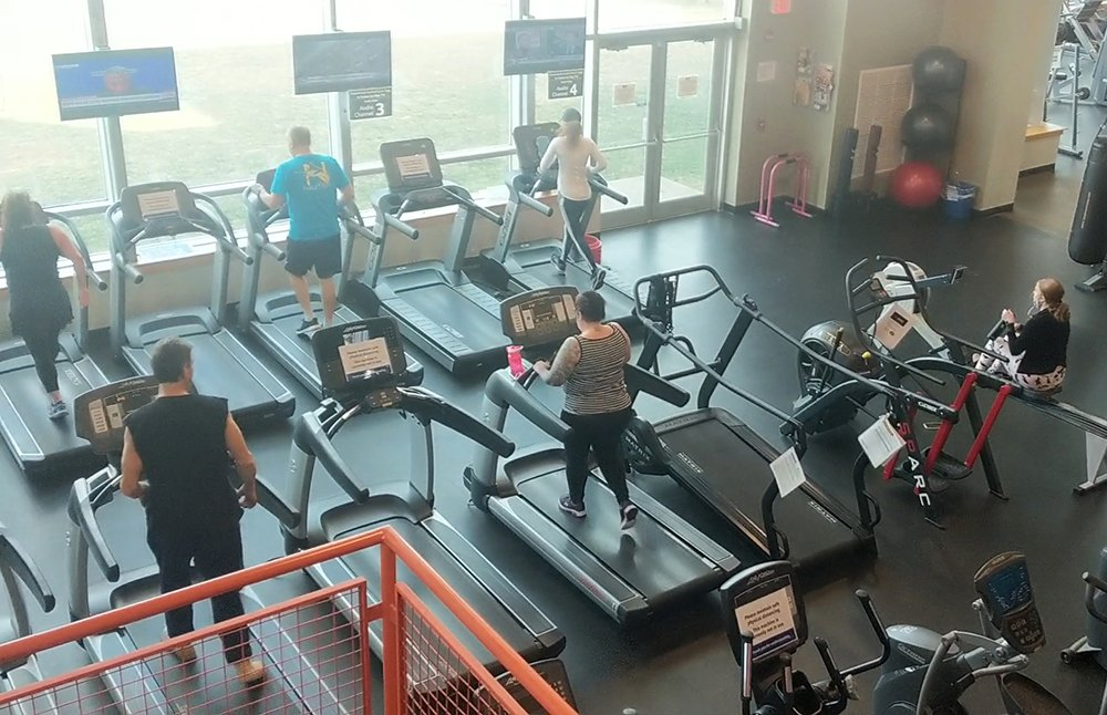 Photo of members using the cardio room at the fitness center.