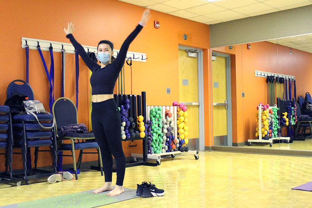 Female-presenting member in a PiYo group fitness class.