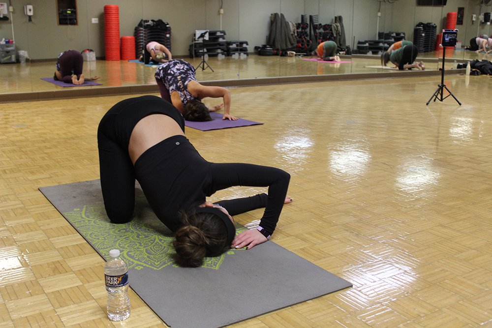A member doing yoga in Studio 1.
